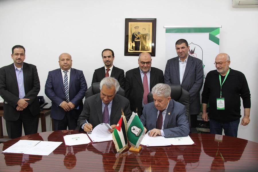 جامعة اليرموك توقع مع المجموعة المتحدة لإتاحة رسائلها الجامعية الكترونيا